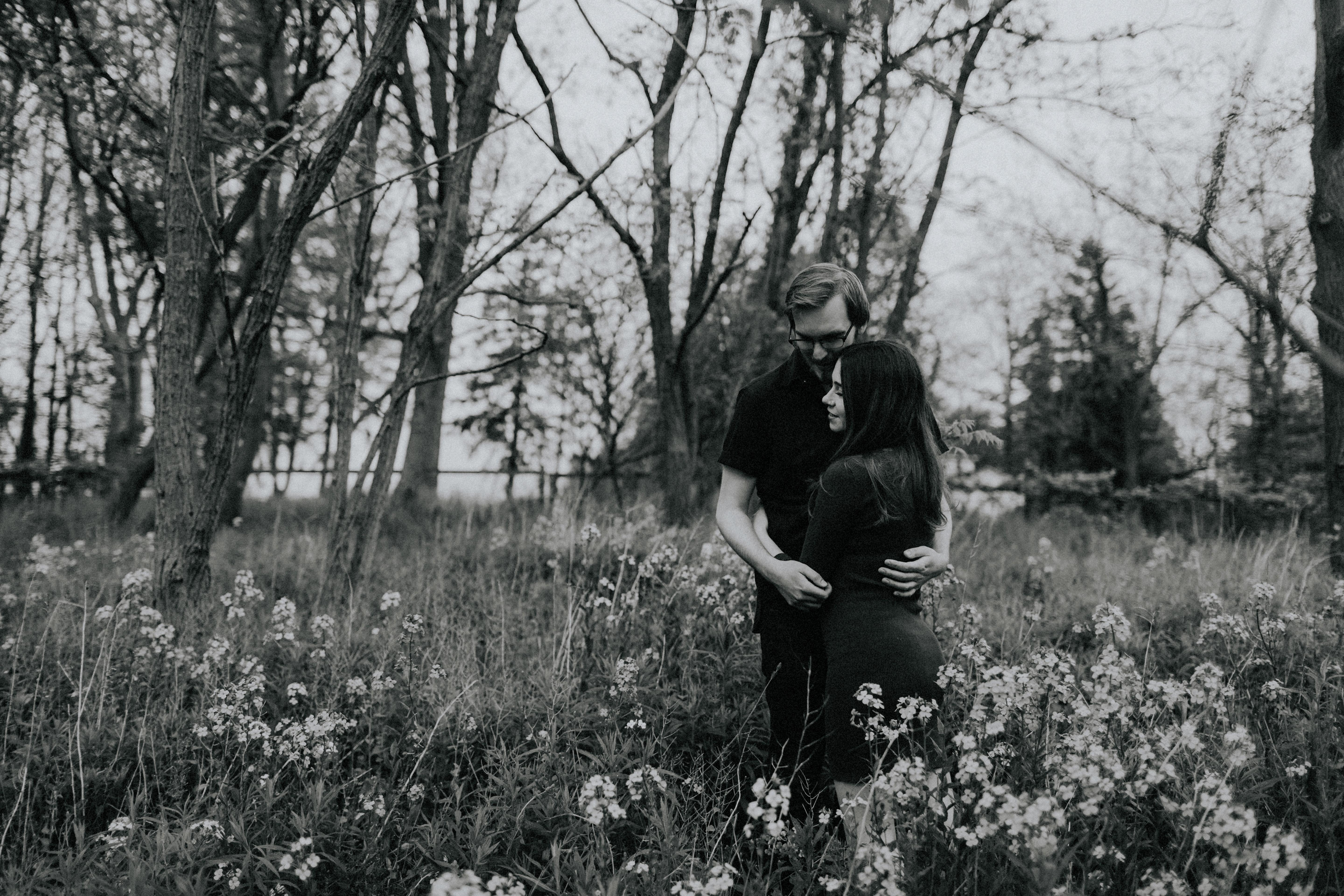 couple embrace in wildflowers