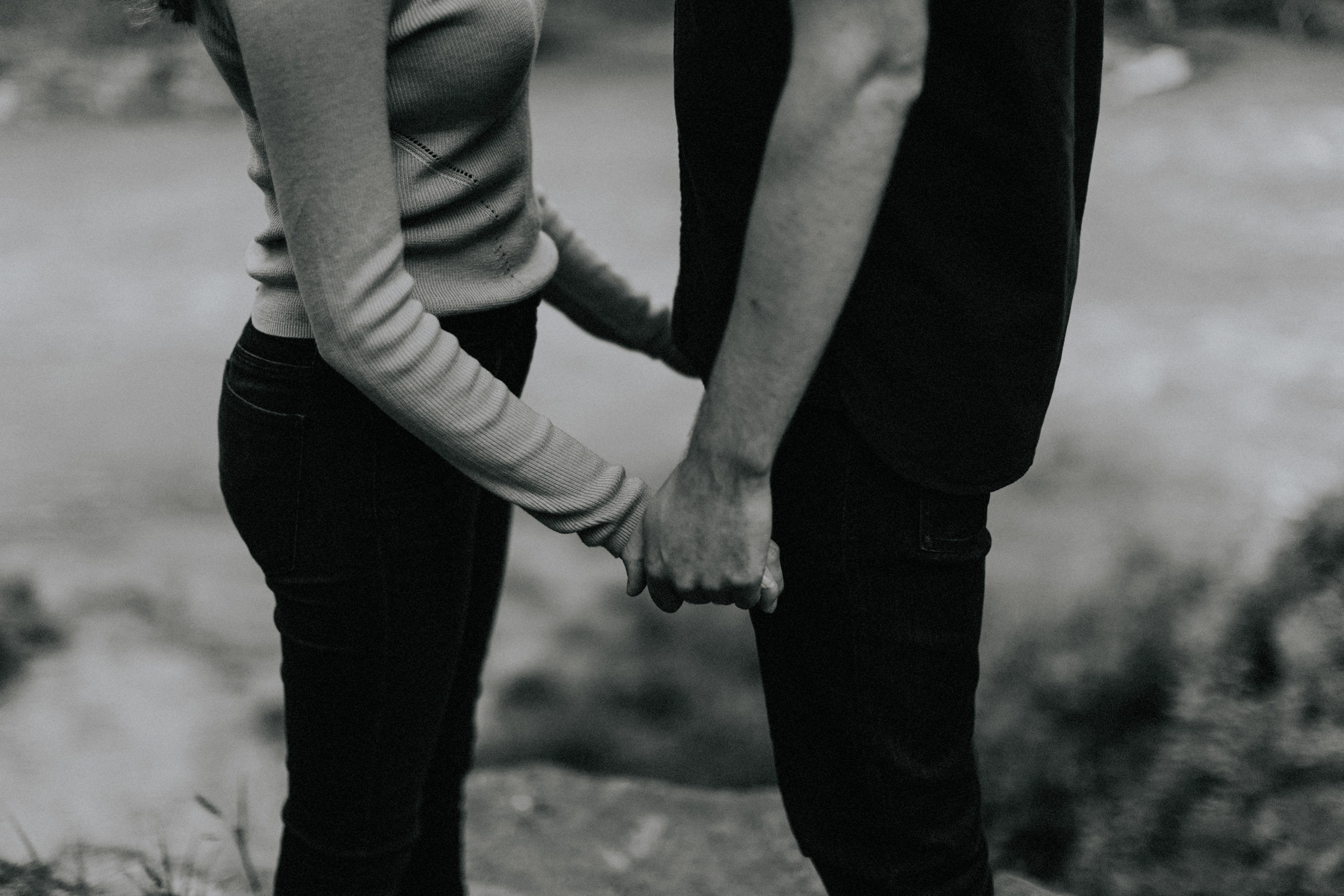 holding hands by stream