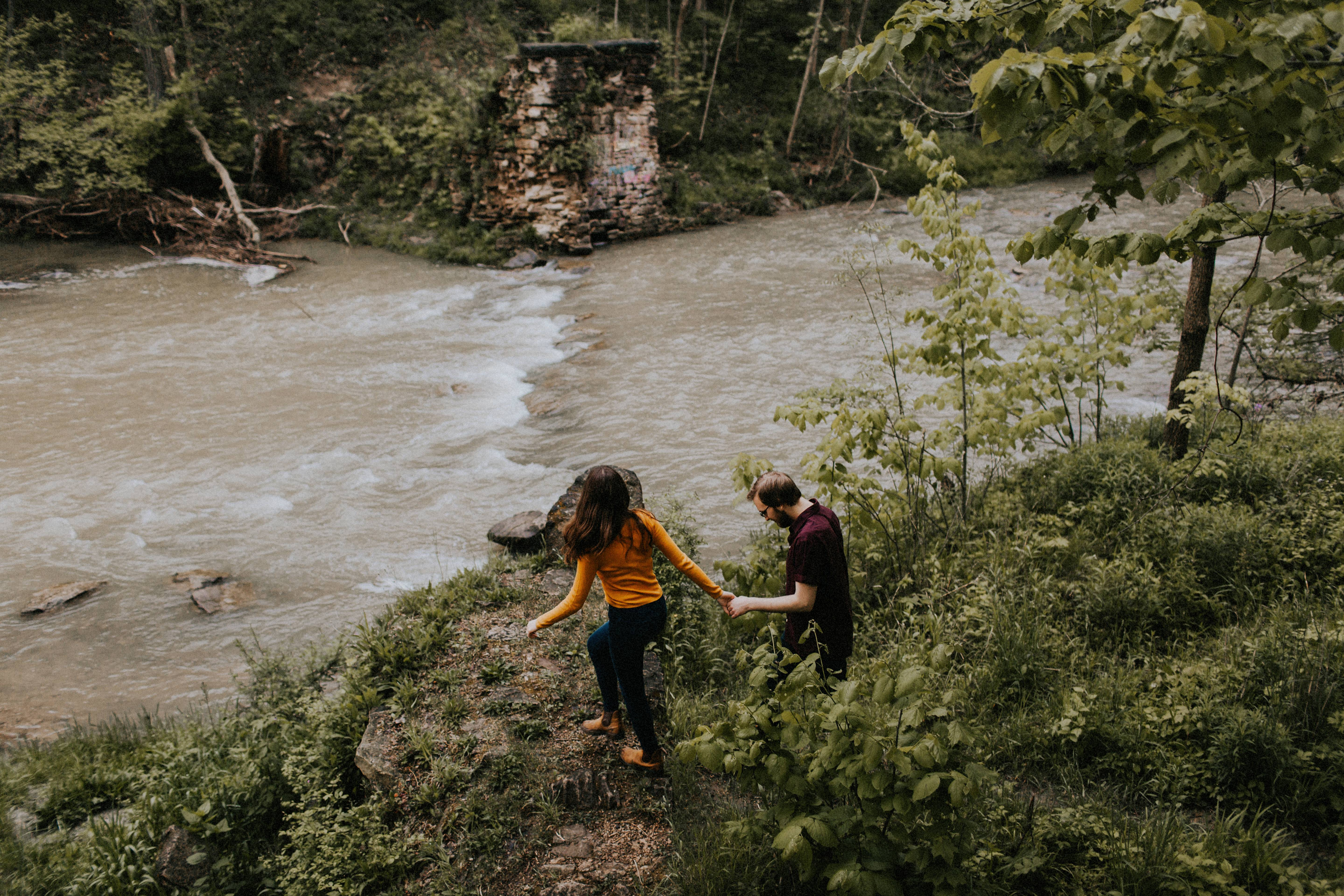 couple walking by stream