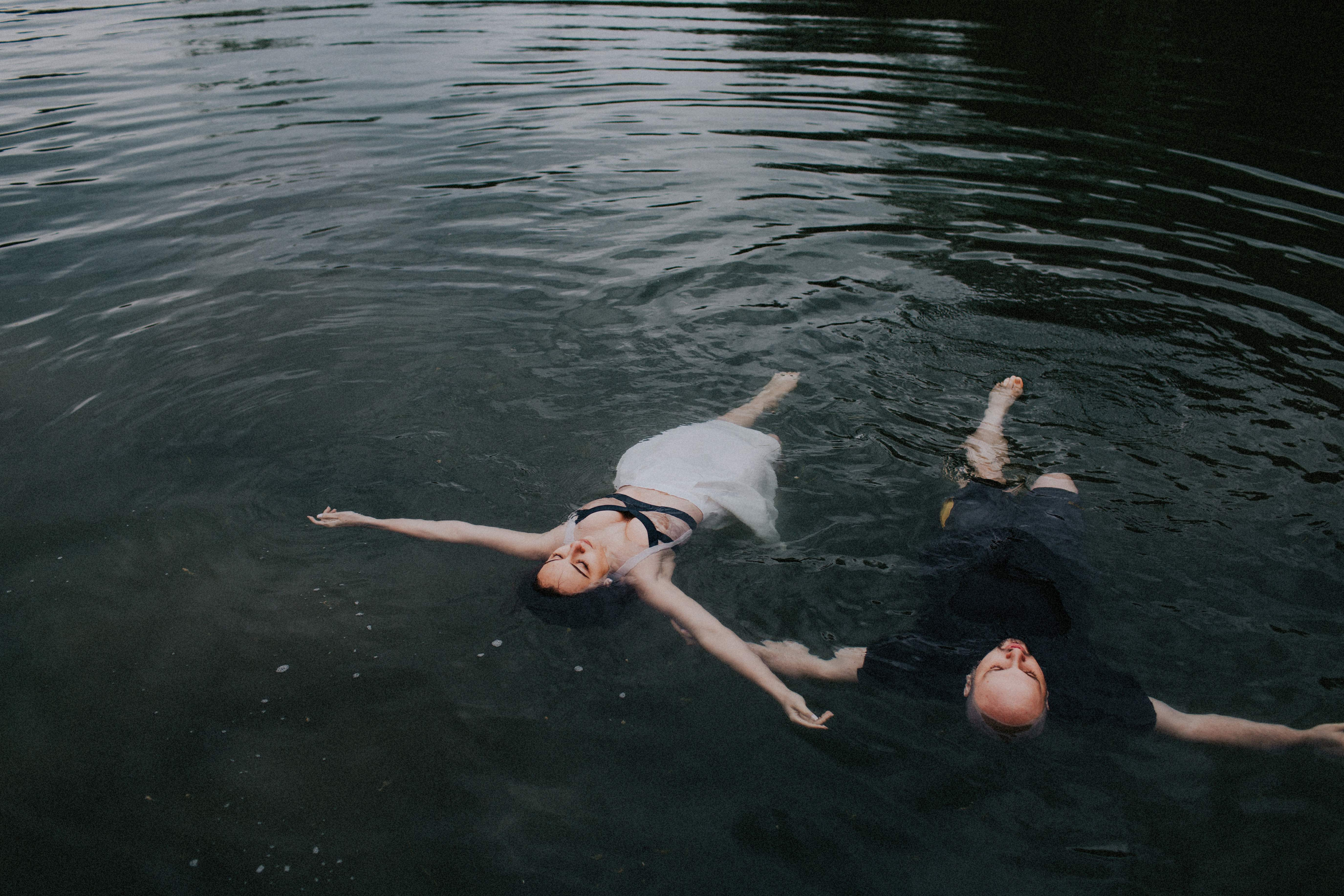 bride and groom float in water