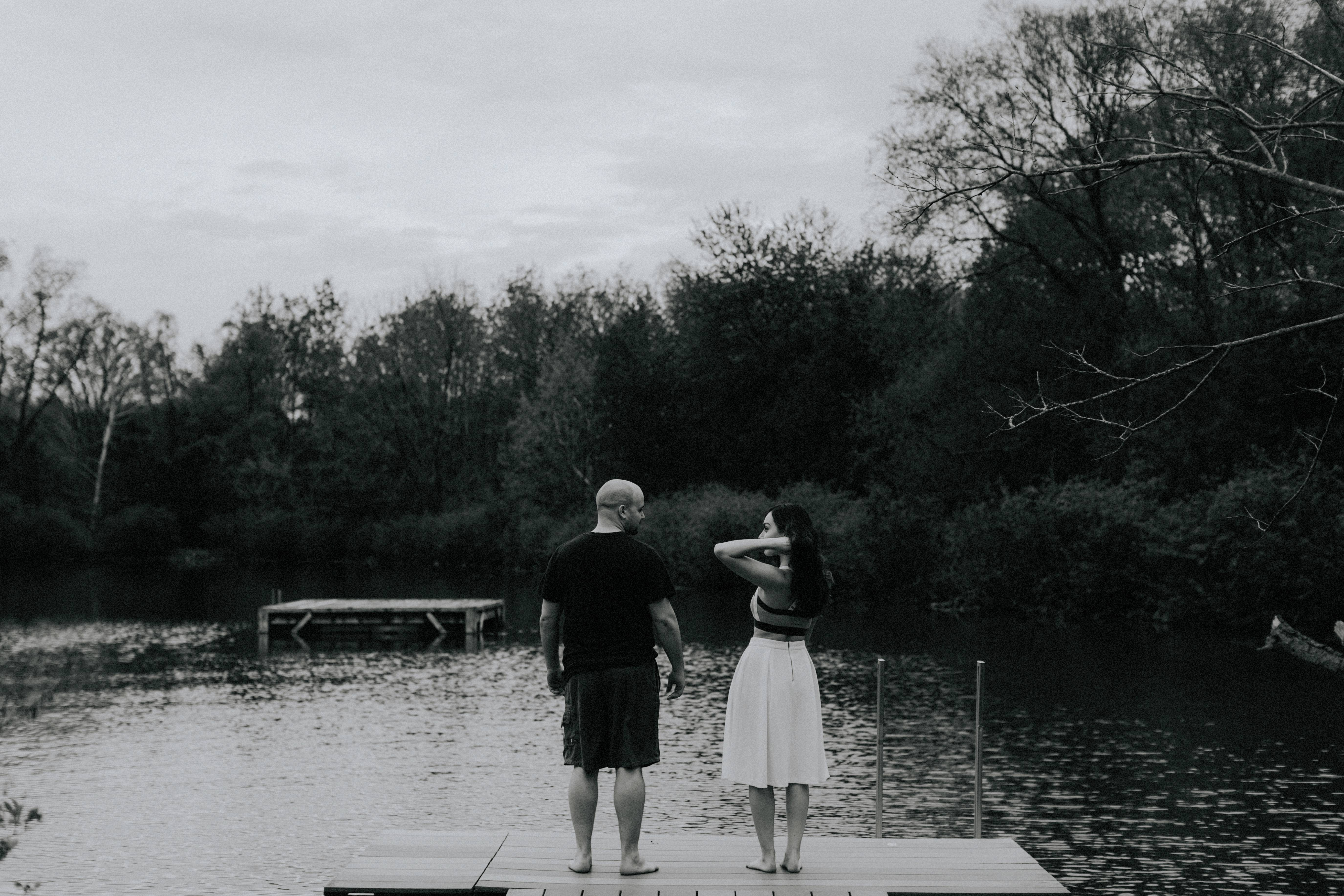 couple standing at edge of dock