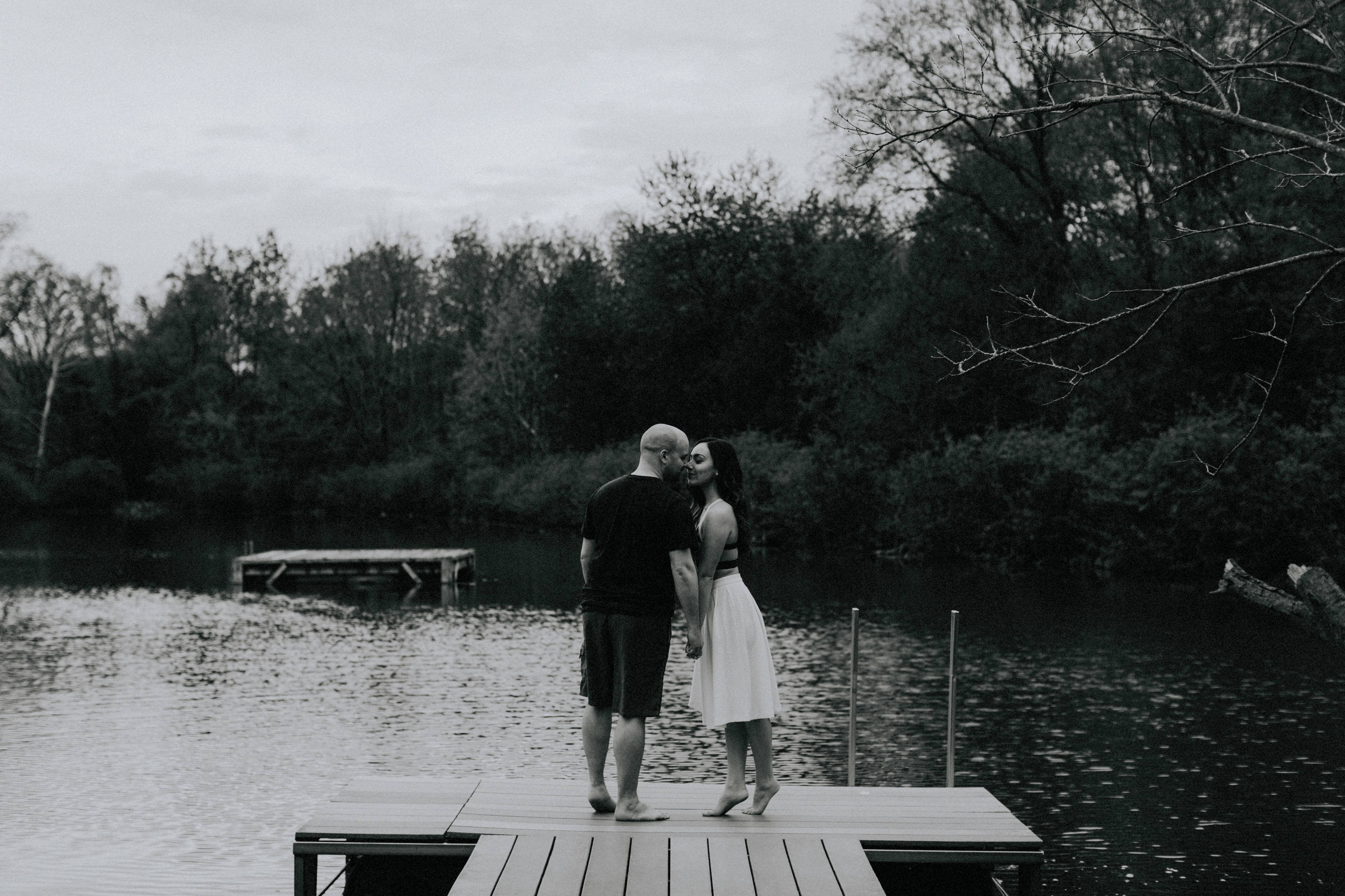 couple kissing at edge of dock