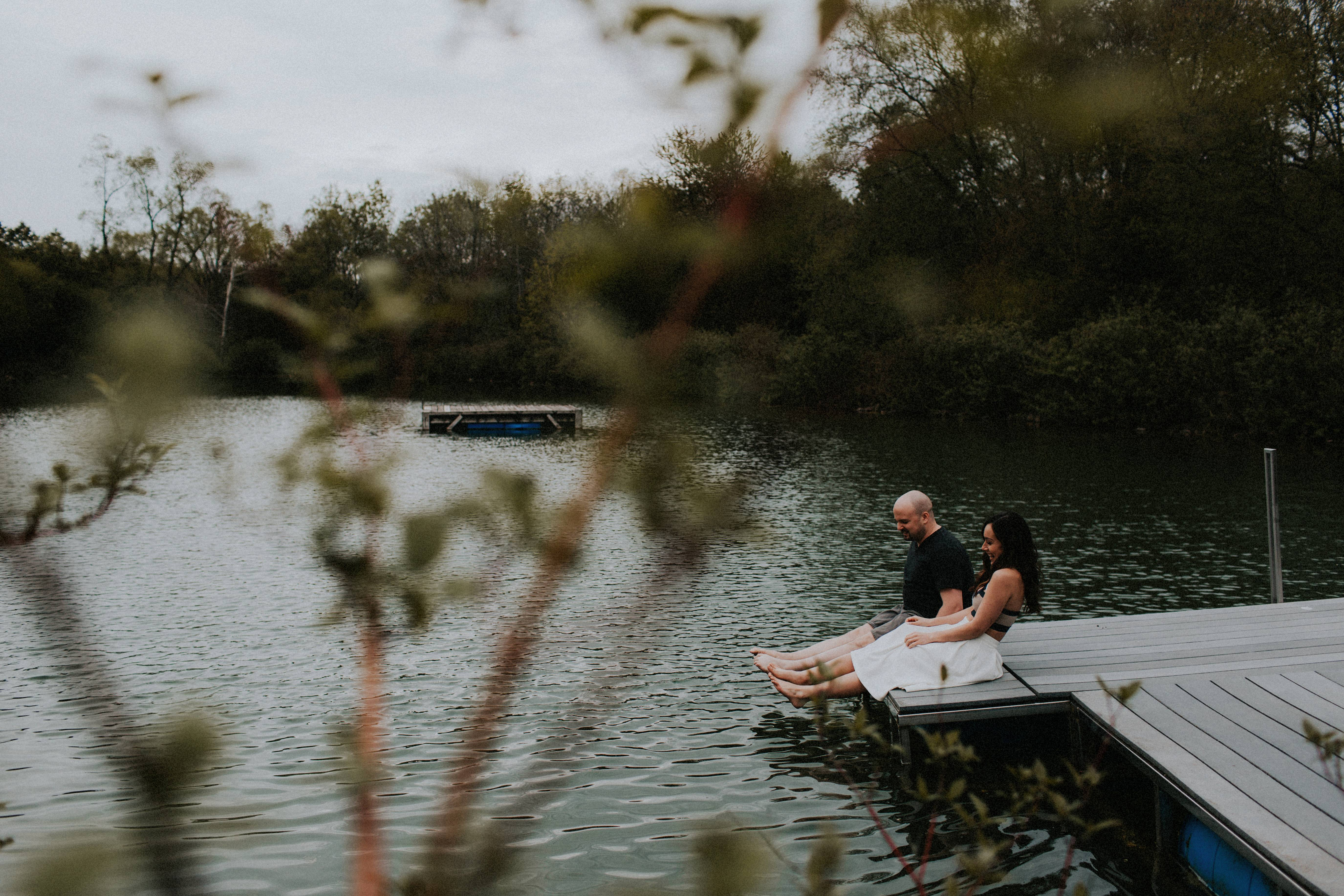 couple hanging out on dock