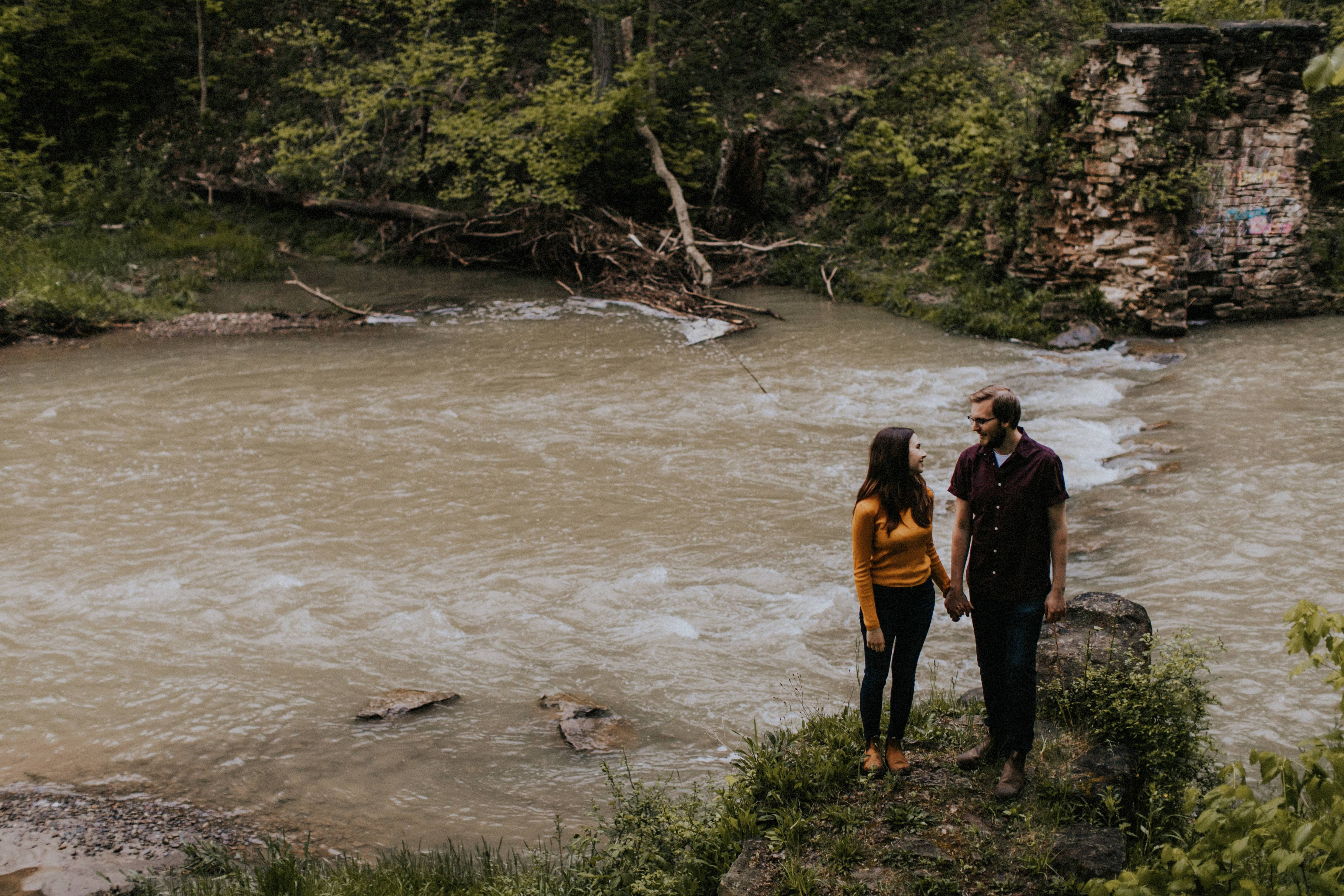 couple standing by stream