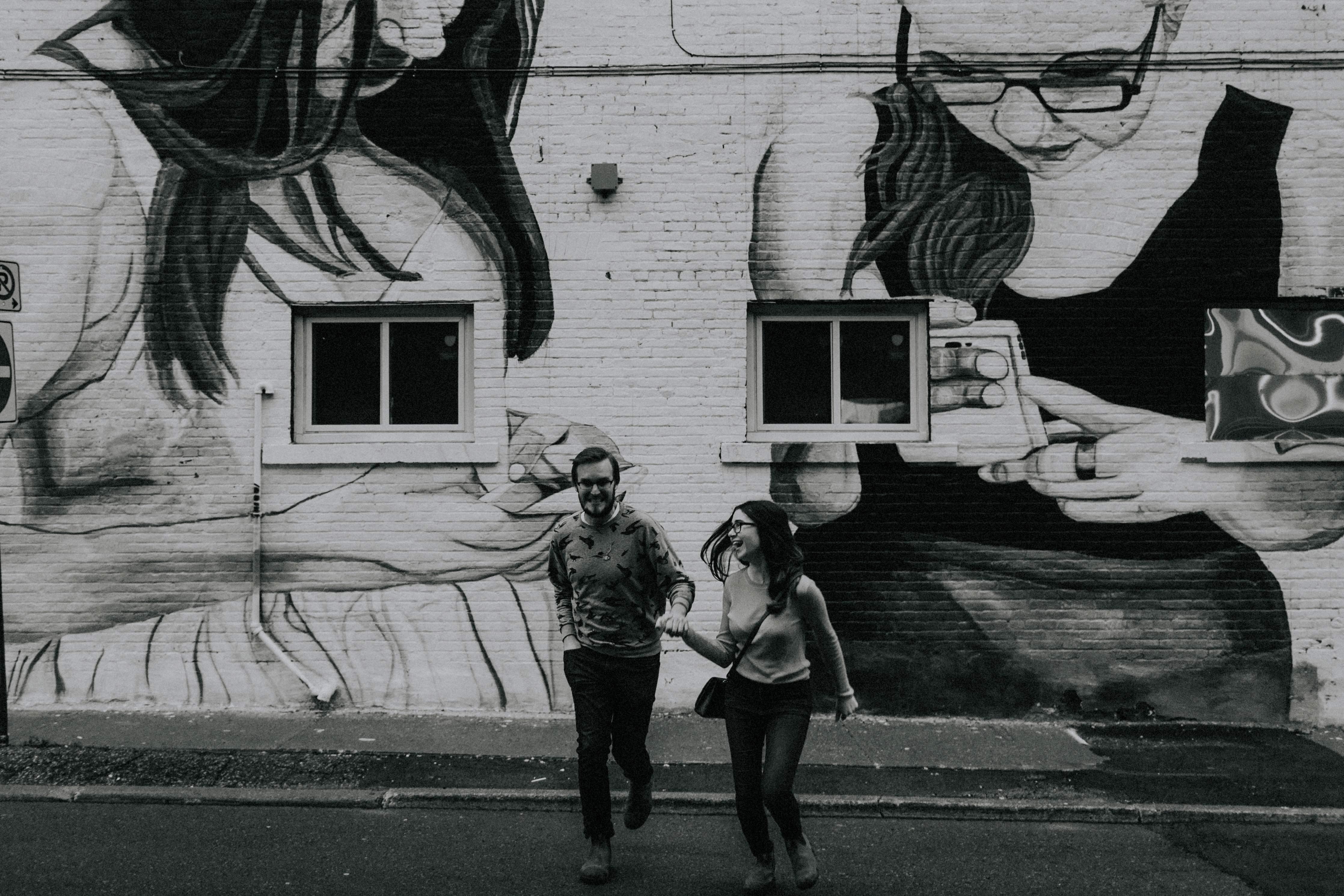 couple running by graffiti