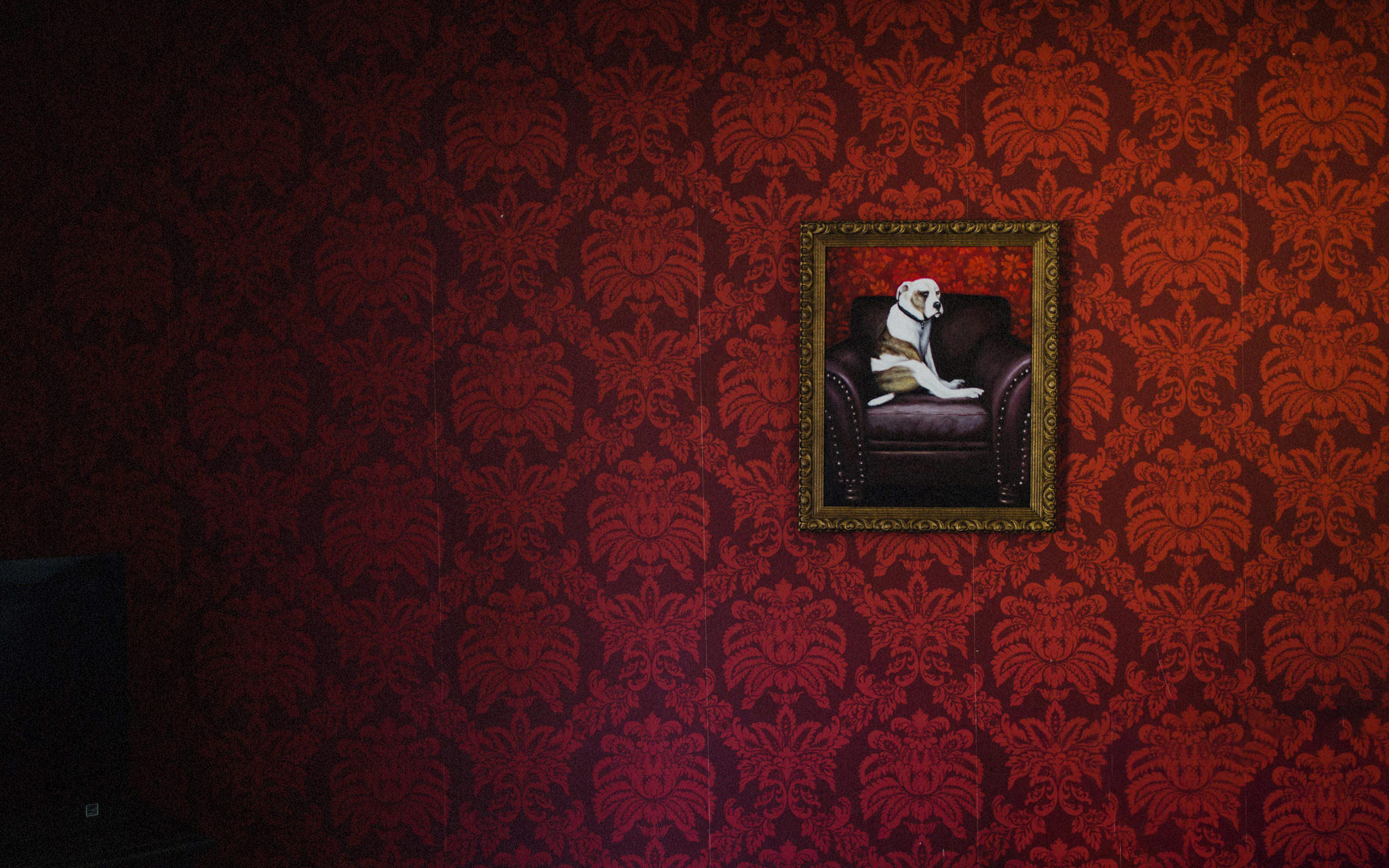 formal painting of dog on a chair