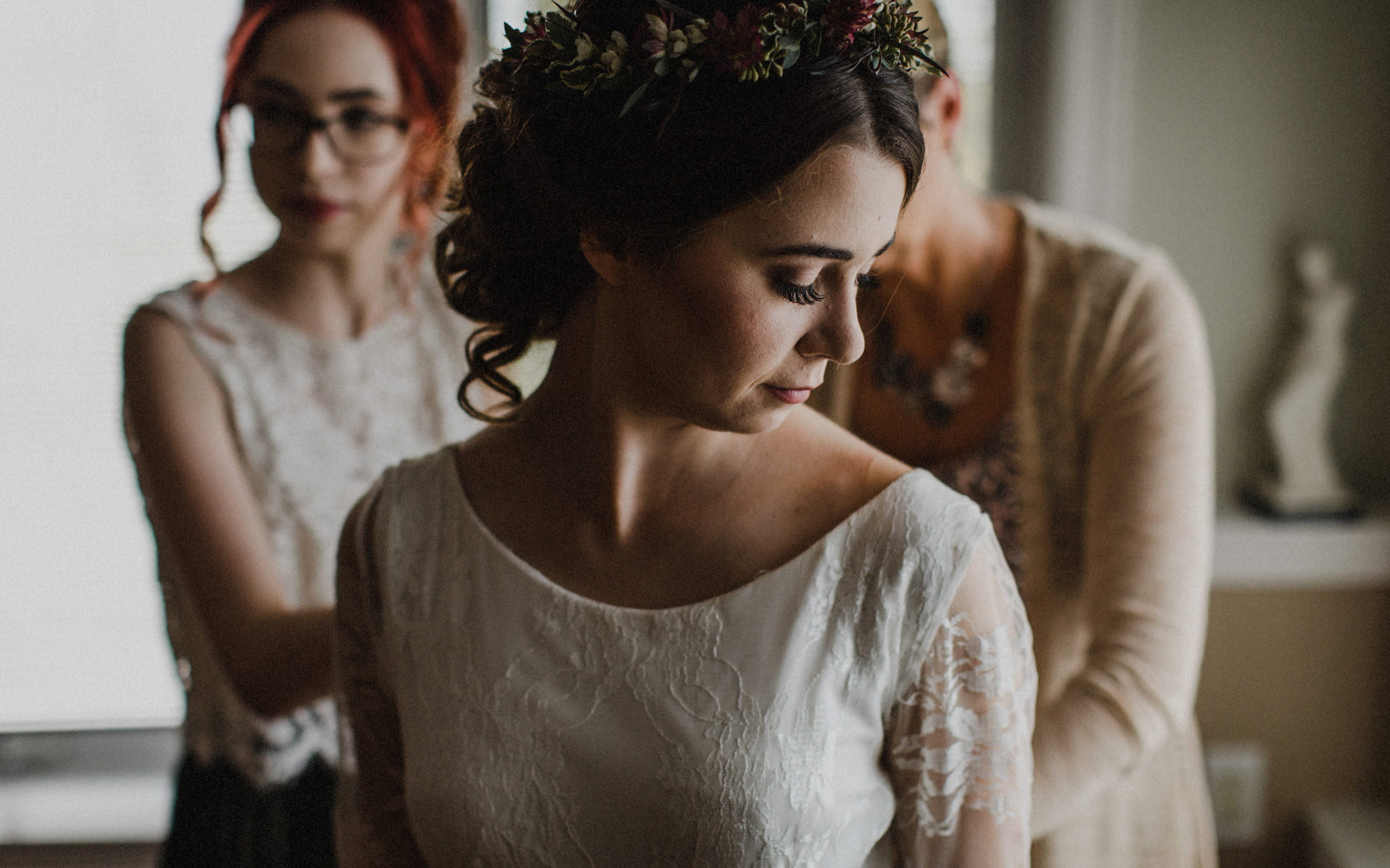 mother and sister do up brides dress