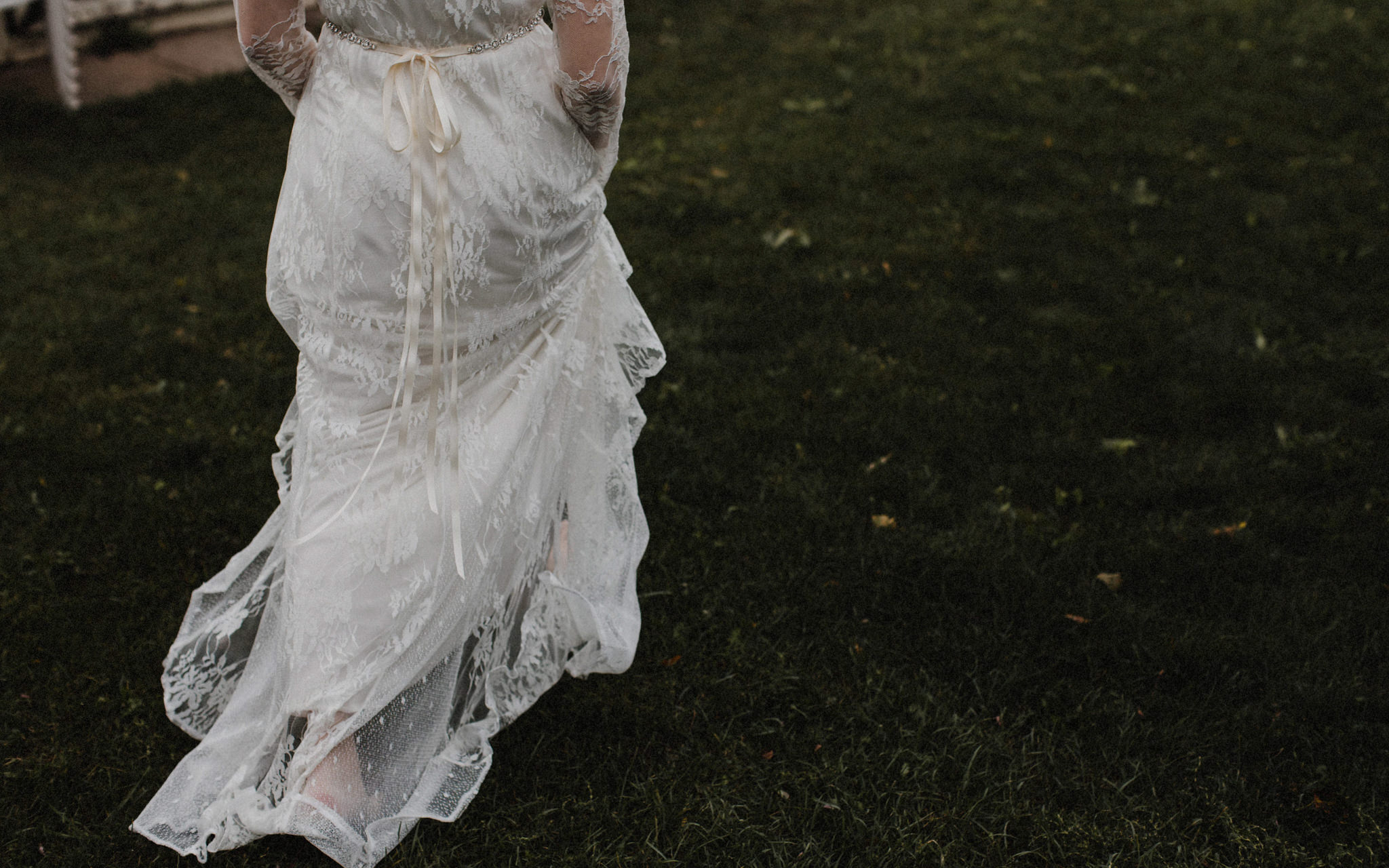 bride holding dress and walking