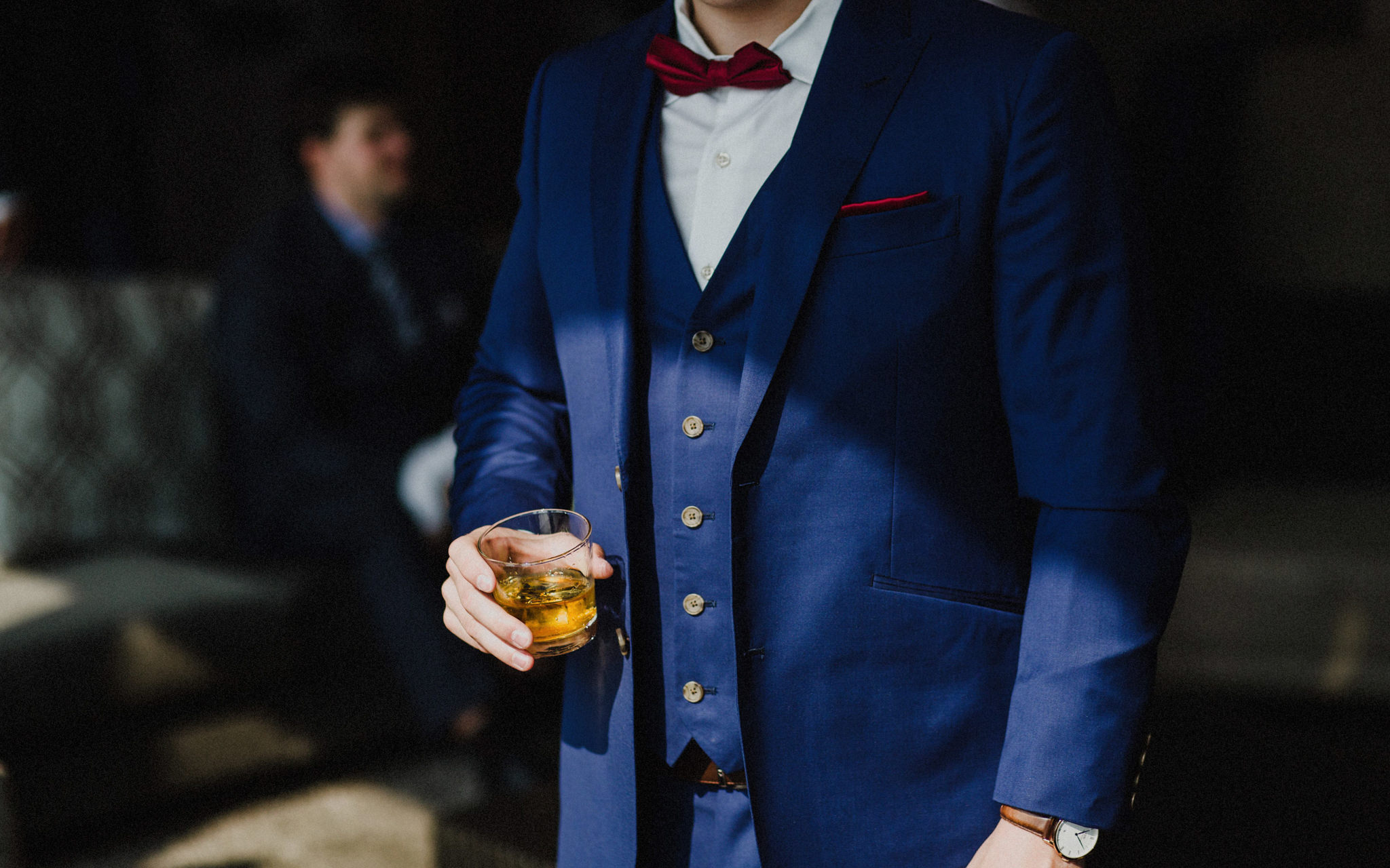groom holds scotch