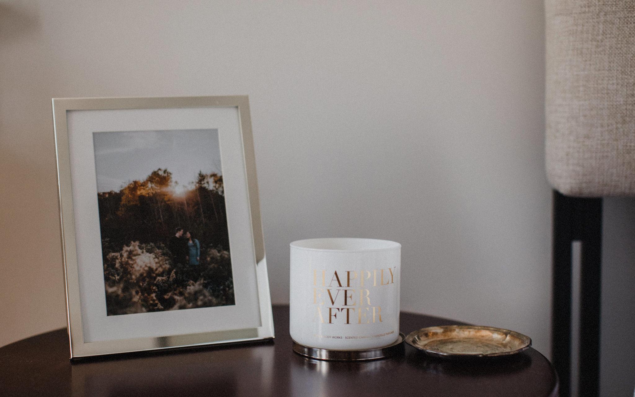 engagement photo framed beside bed