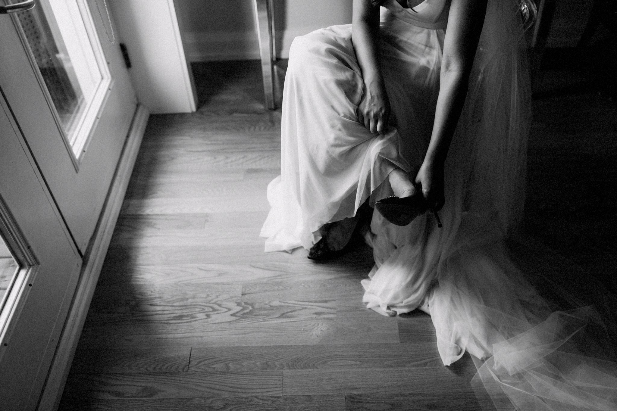 bride puts her shoes on