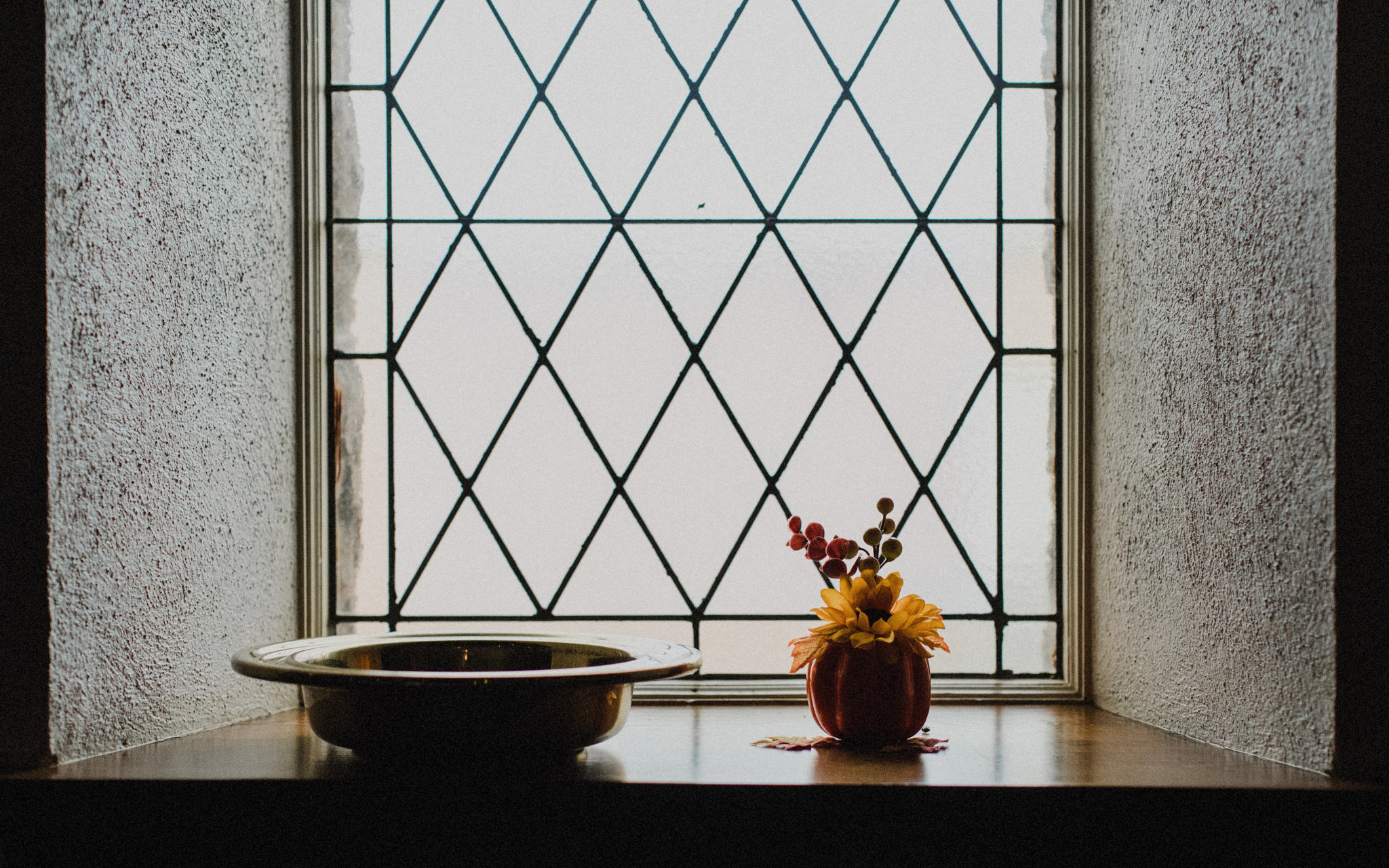 offering dish by church window