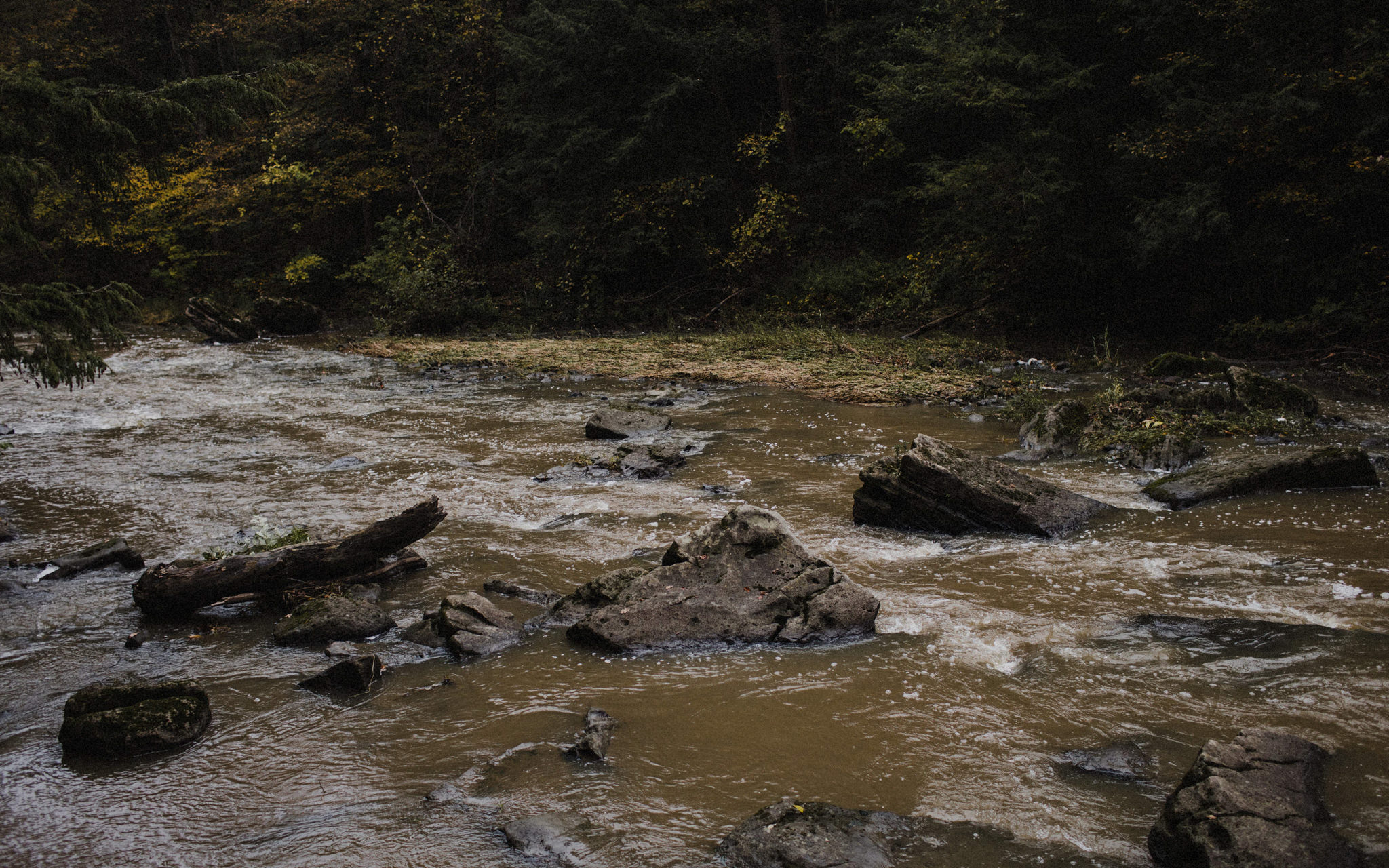 water rushes over rocks