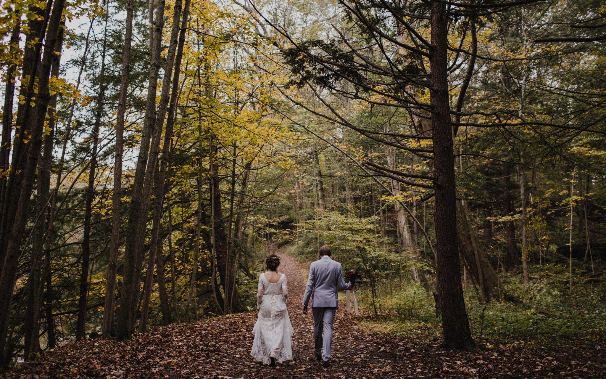 bride and groom wander in forest