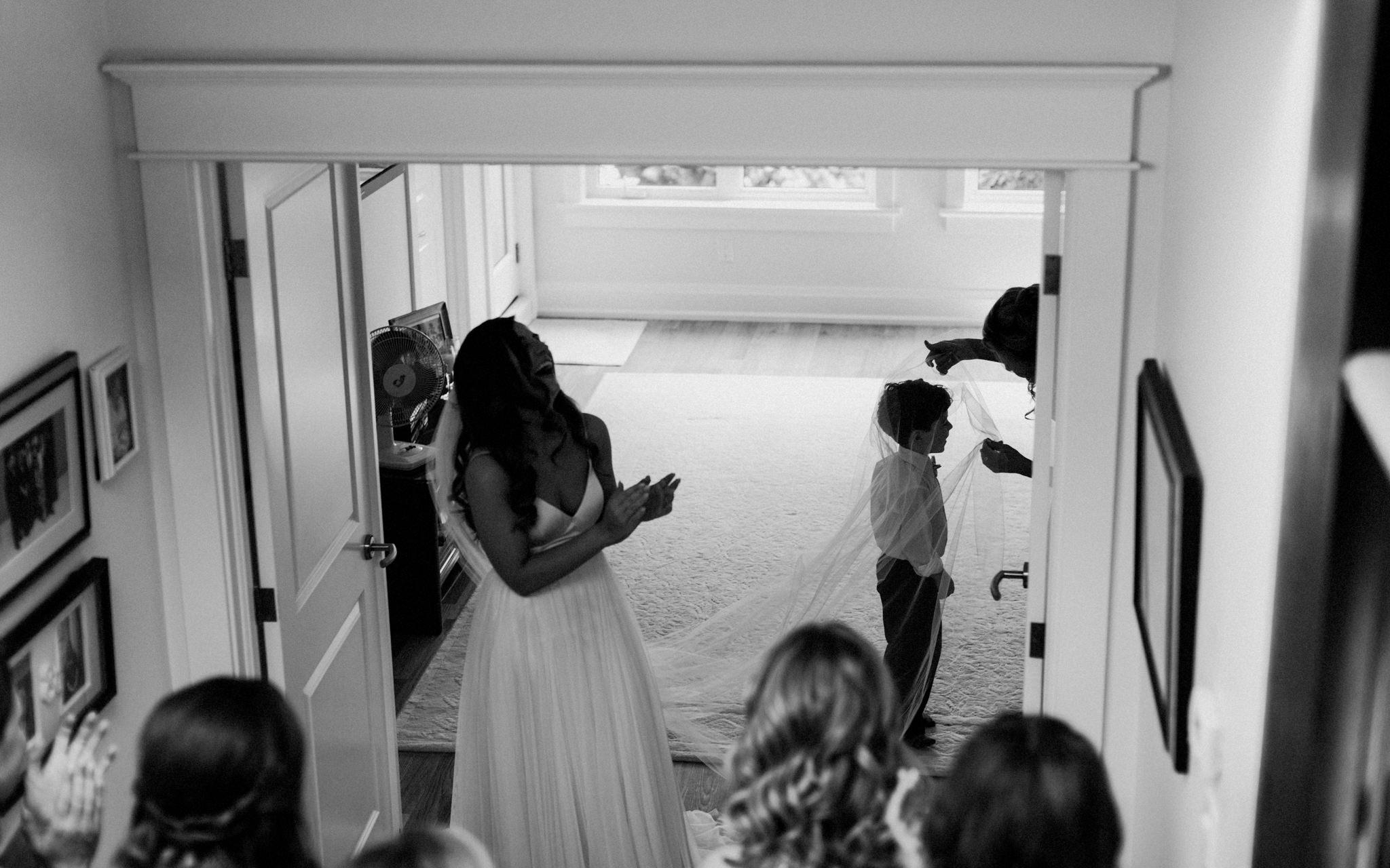 bride's nephew wears veil