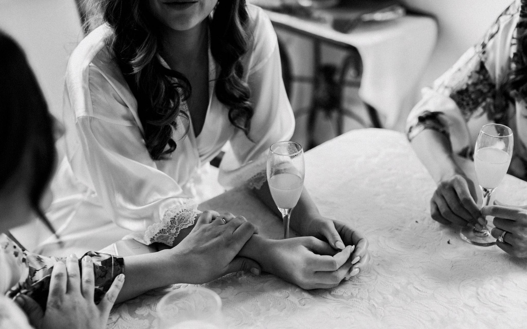 bridesmaid holds brides hand