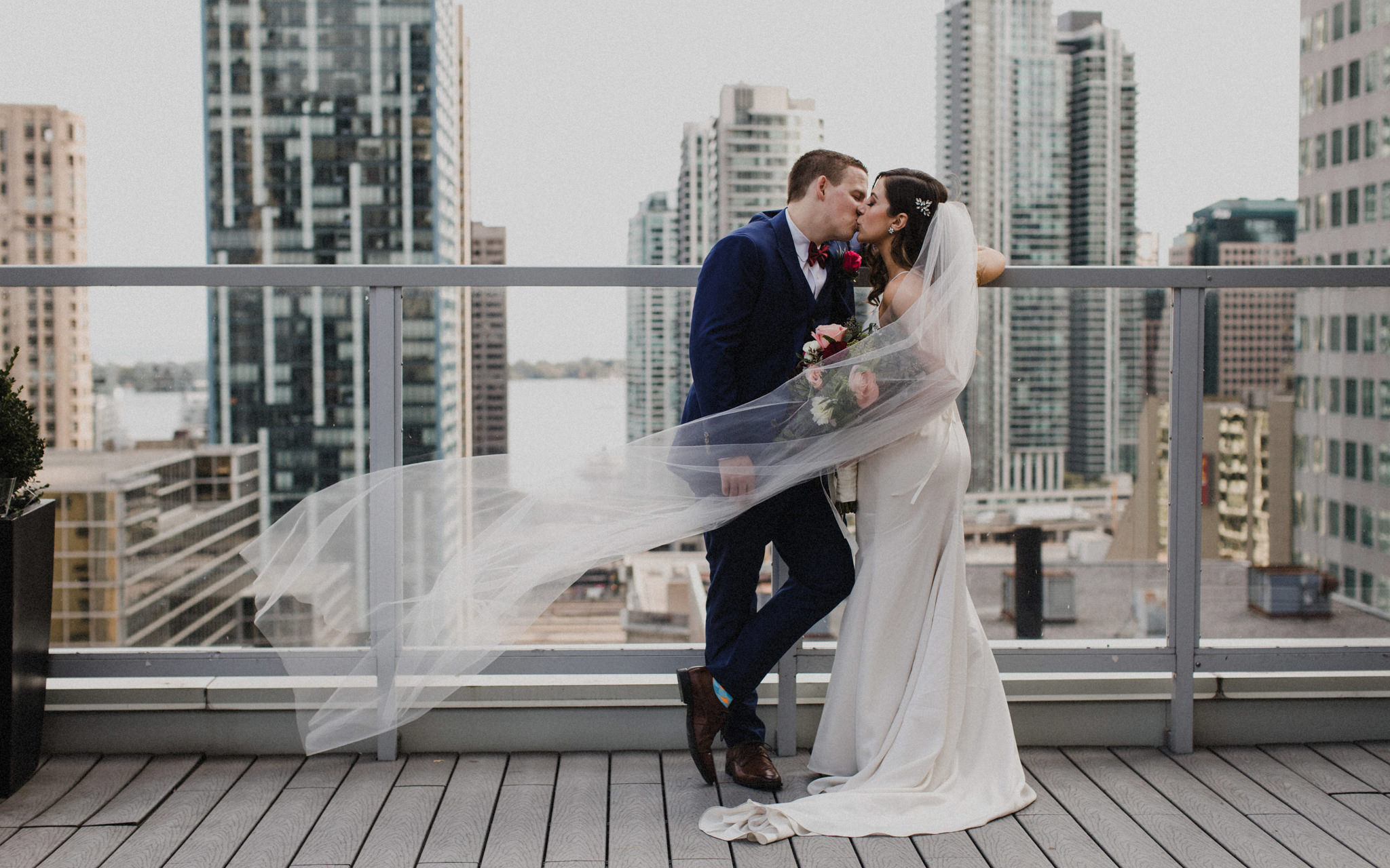 kiss on rooftop at downtown toronto wedding