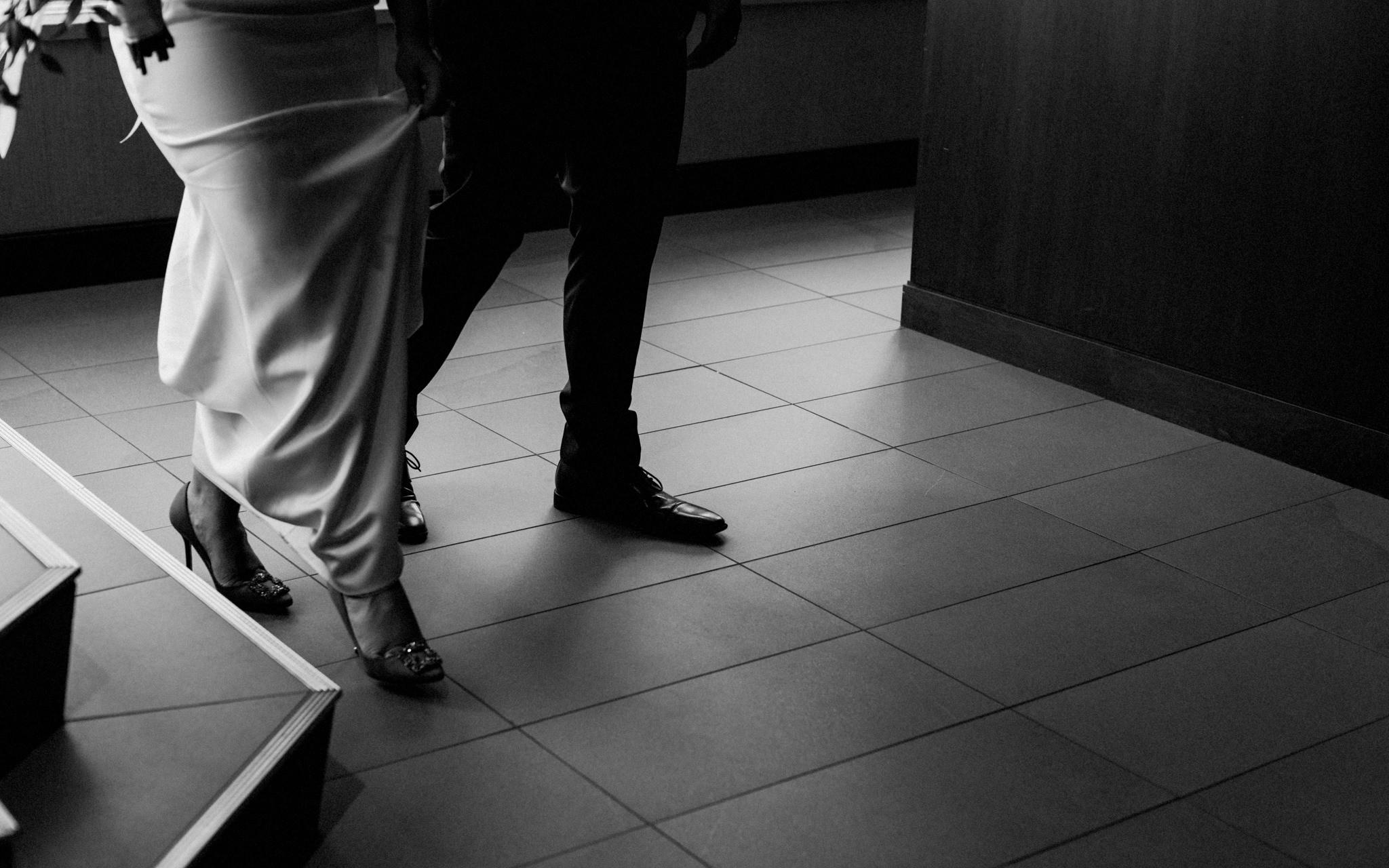 shoe detail bride groom walking