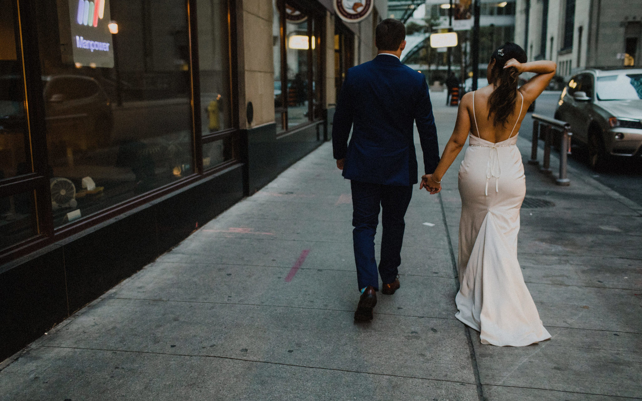 bride and groom walking downtown
