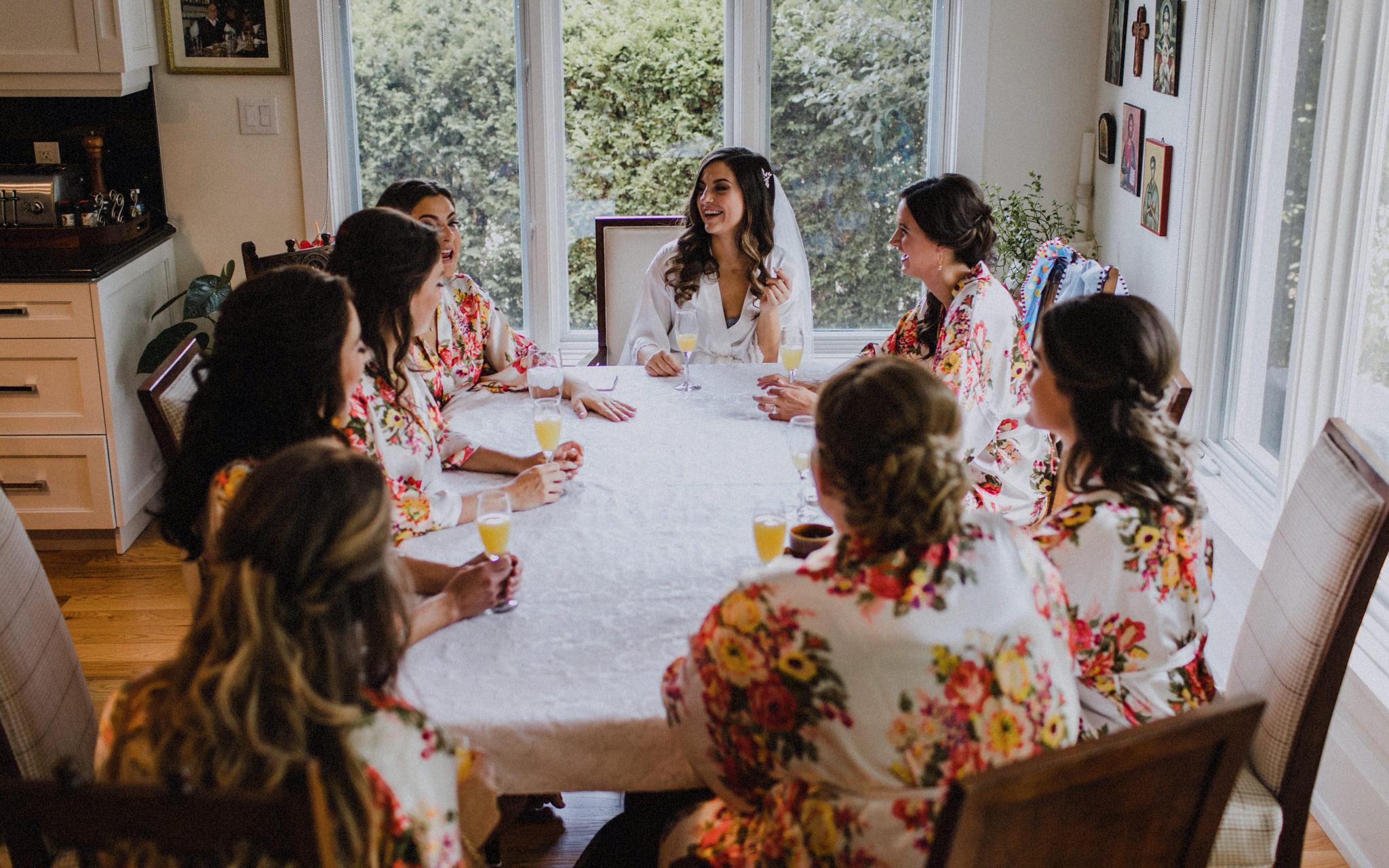 bride and bridesmaids share a mimosa