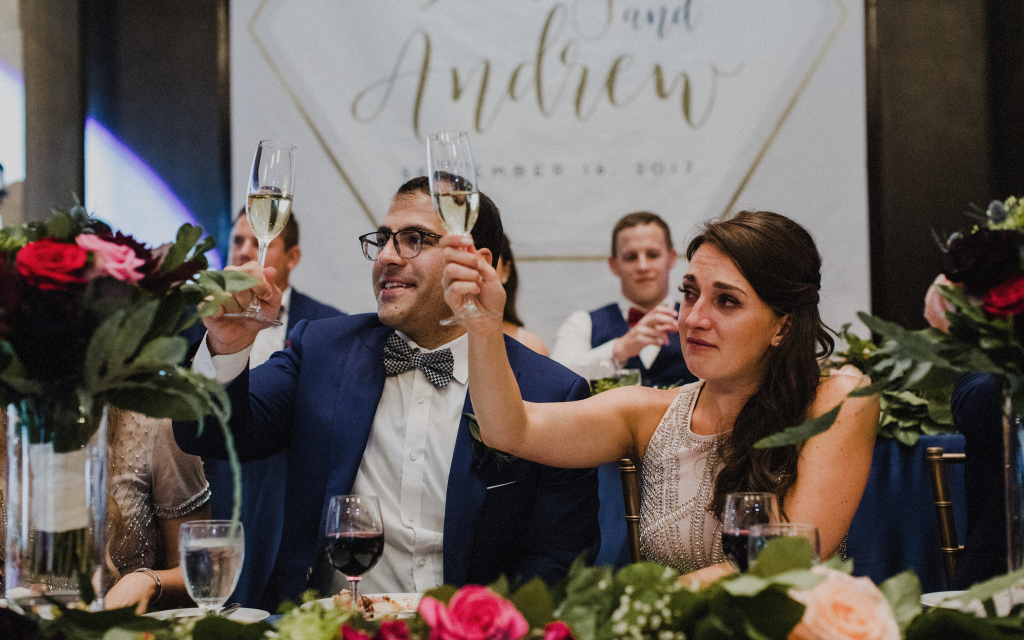 bridal party toasts at reception