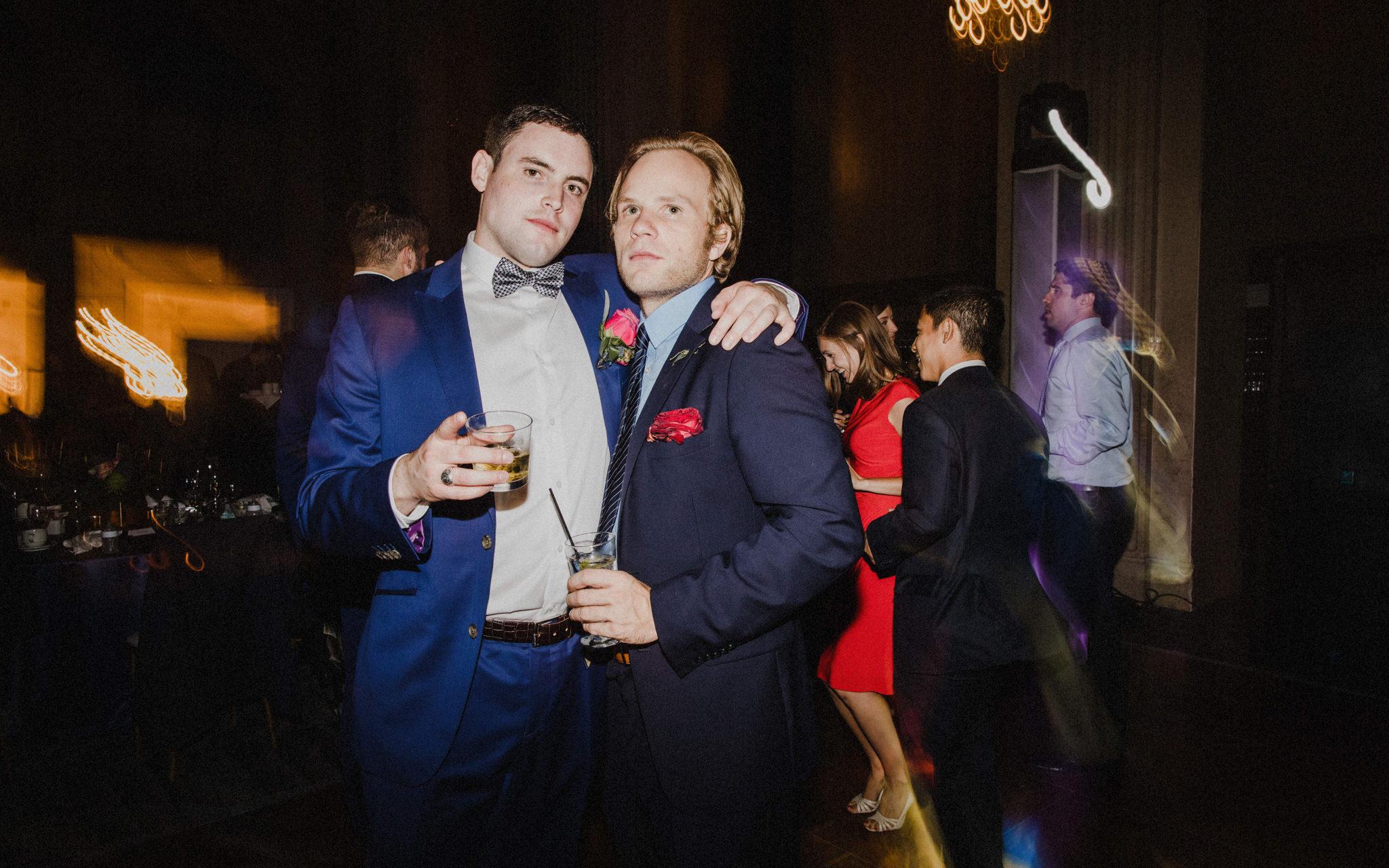 groomsmen pose during wedding reception