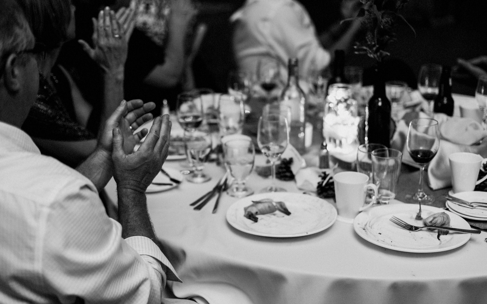 table applauds at wedding