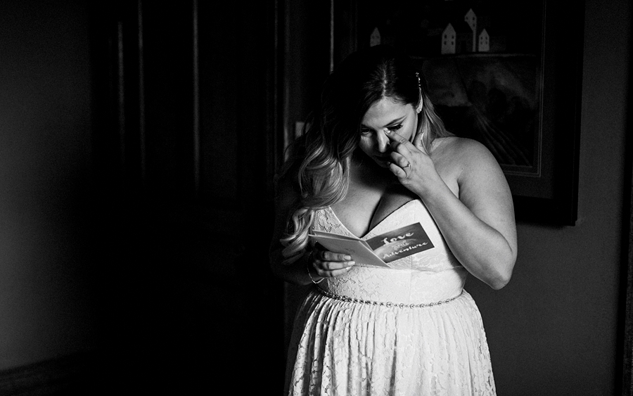 bride crying over letter