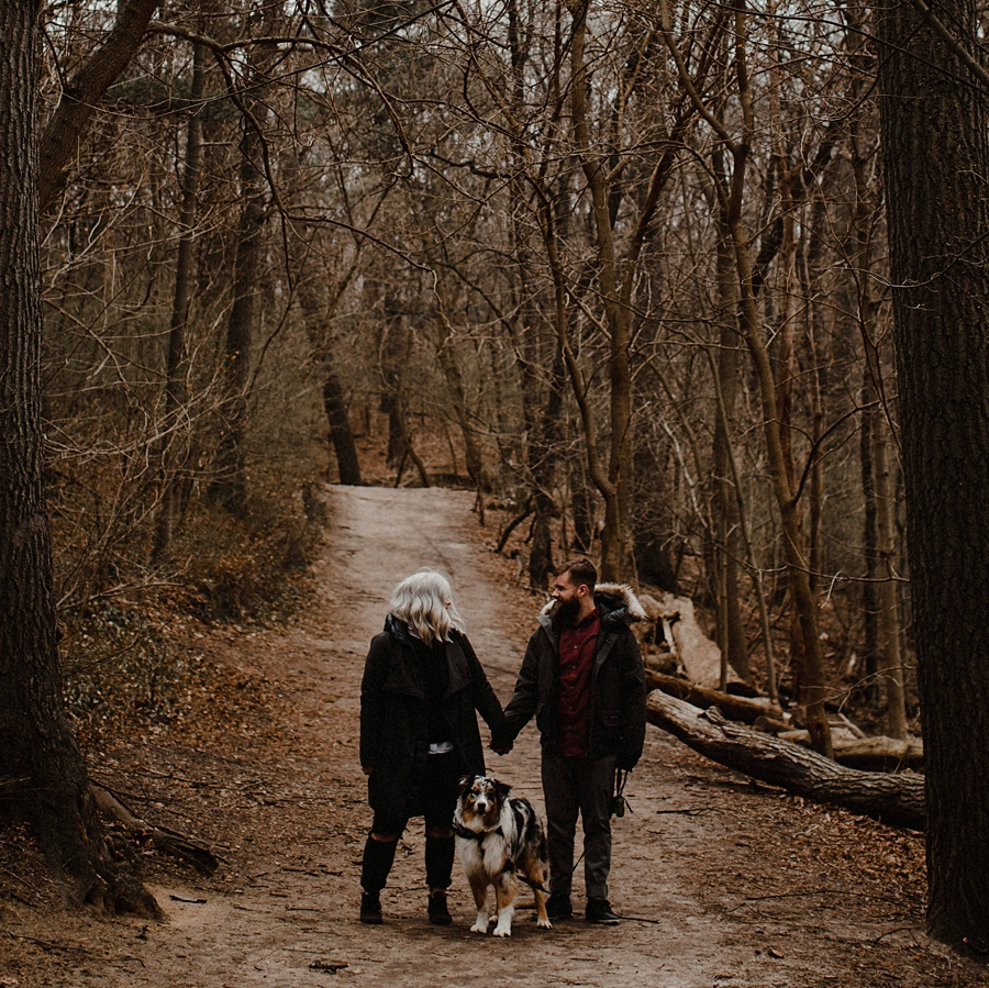 couple holds hands at high park engagement