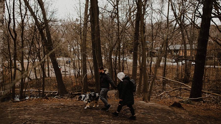 couple stroll through mud