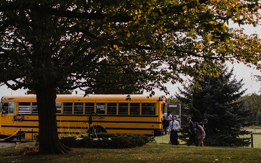 wedding guests arrive by bus