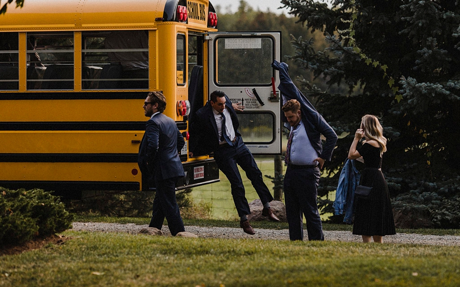 wedding guests hop out of bus