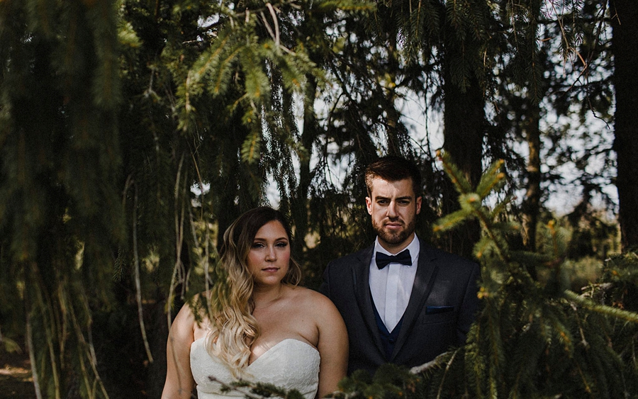 bride groom in pine trees