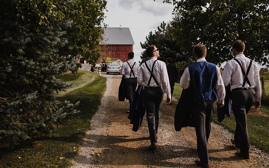groomsmen walk at farm