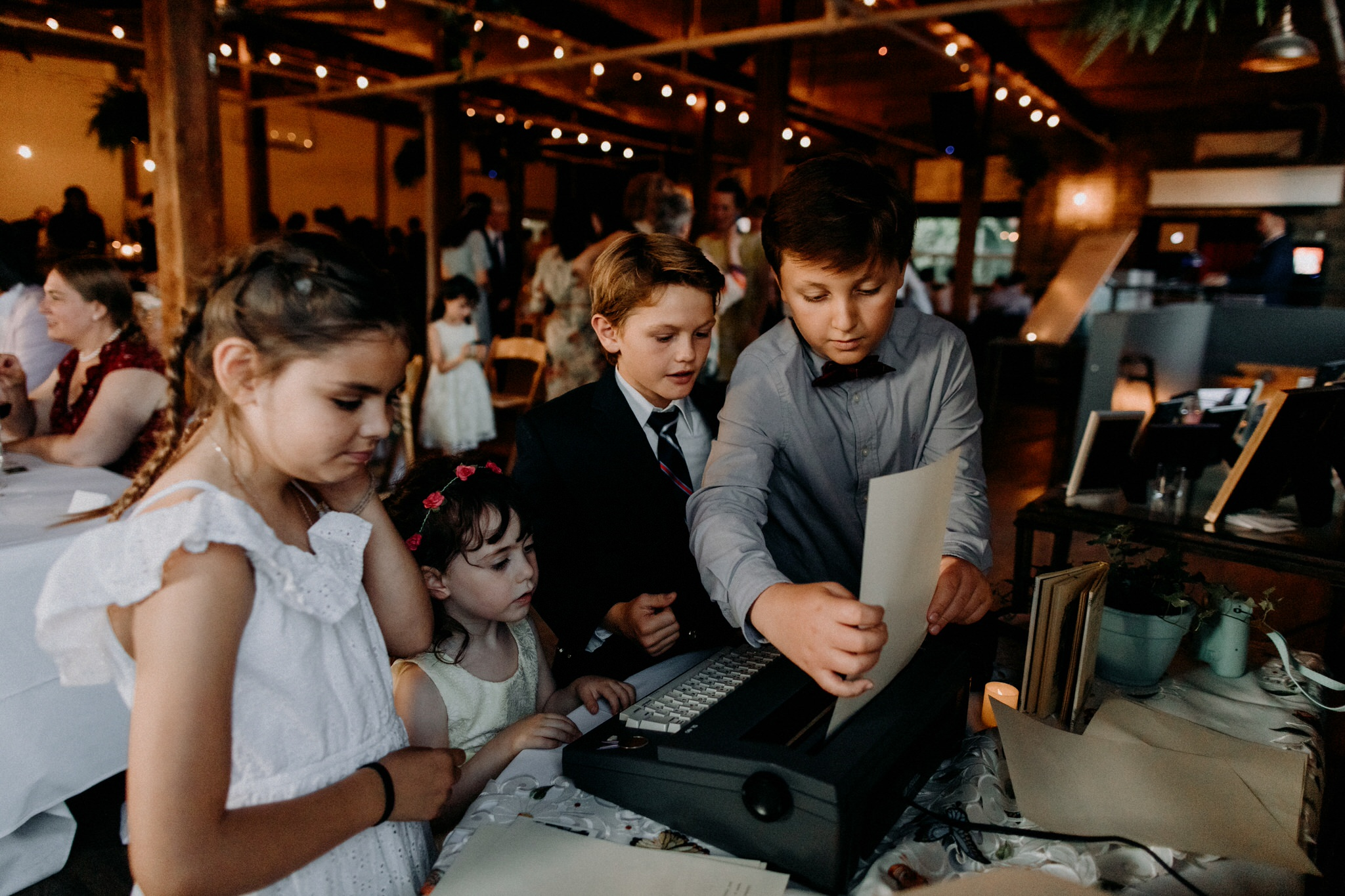 Merchants of Green Coffee Wedding - children using typewriter