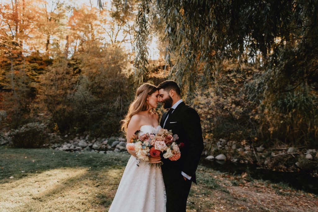 Bride and groom touch foreheads under backlit willow tree - Autumn Micro Wedding at Berkeley Fieldhouse