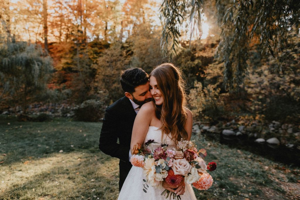 Autumn Micro Wedding at Berkeley Field House - Bride and Groom Embrace in Park