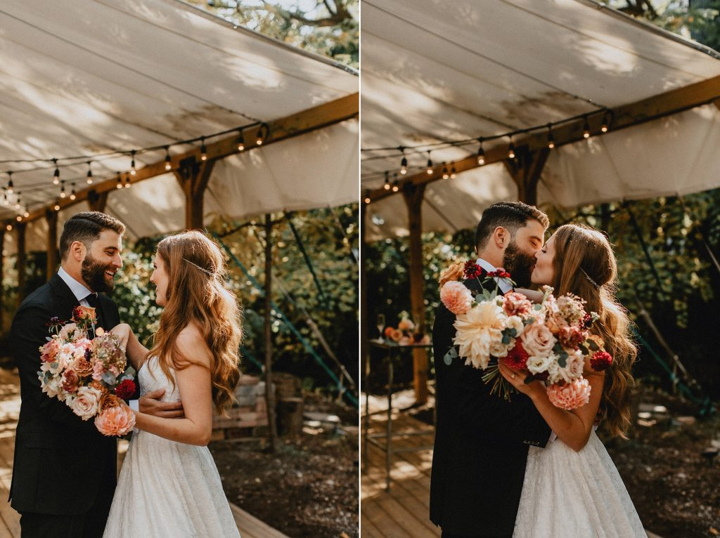 Bride and groom kiss on patio under string-lights - Autumn Micro Wedding at Berkeley Fieldhouse