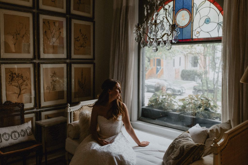 Bride sits in moody window lighting - Autumn Micro Wedding at Berkeley Fieldhouse