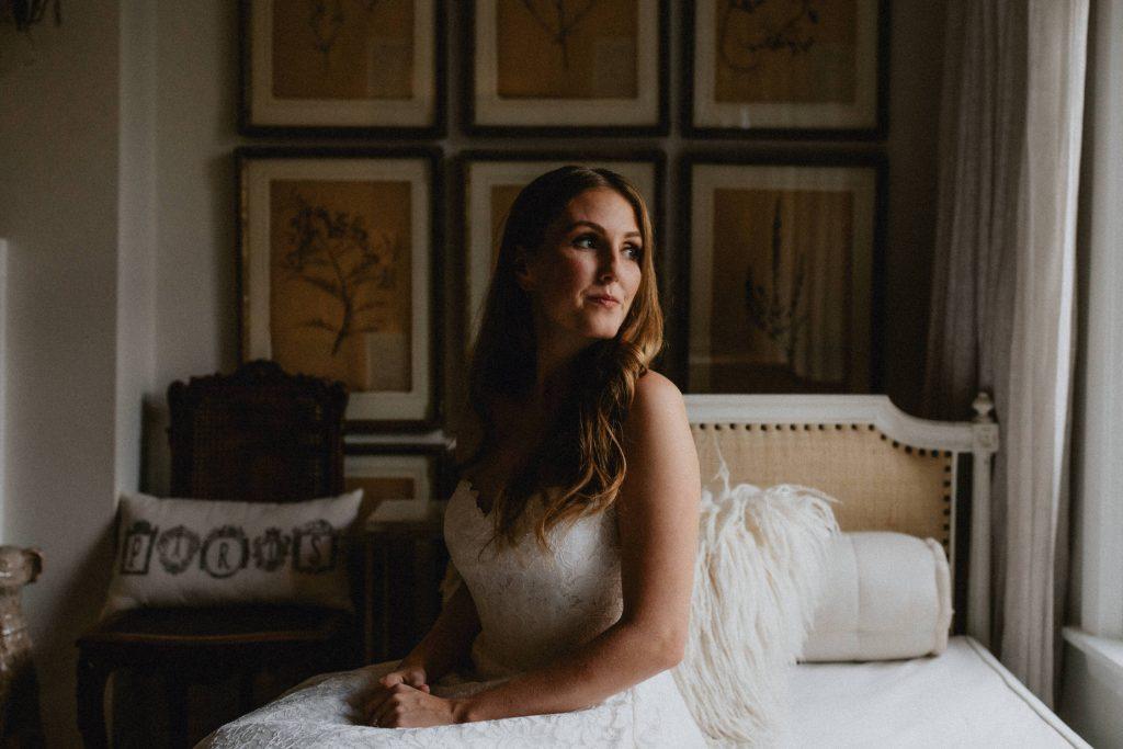 Bride gazes out the window - Autumn Micro Wedding at Berkeley Fieldhouse