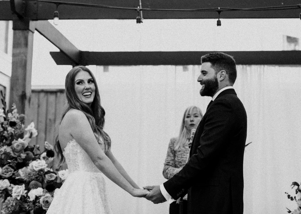 Bride laughs at the alter - Autumn Micro Wedding at Berkeley Fieldhouse
