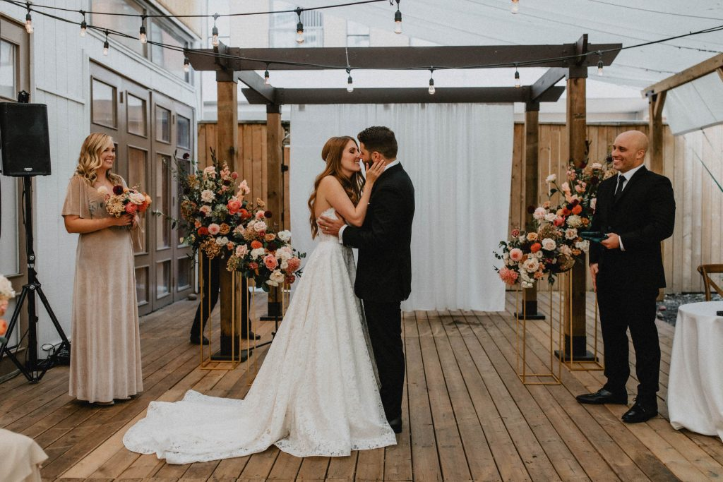 Bride and groom kiss at the alter - Autumn Micro Wedding at Berkeley Fieldhouse