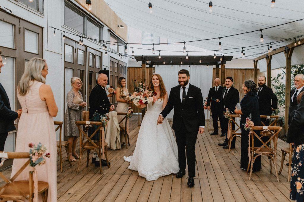 Bride and groom walk down the aisle - Autumn Micro Wedding at Berkeley Fieldhouse