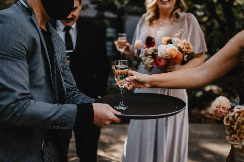 Guest takes champagne - Autumn Micro Wedding at Berkeley Fieldhouse
