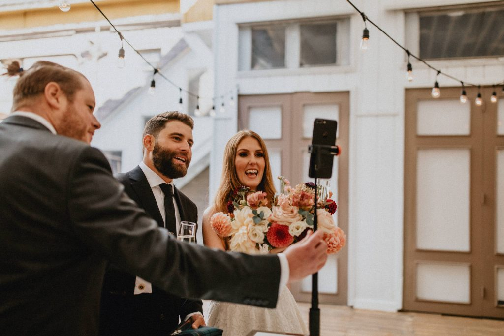 Bride and groom connect with remote guests - Autumn Micro Wedding at Berkeley Fieldhouse