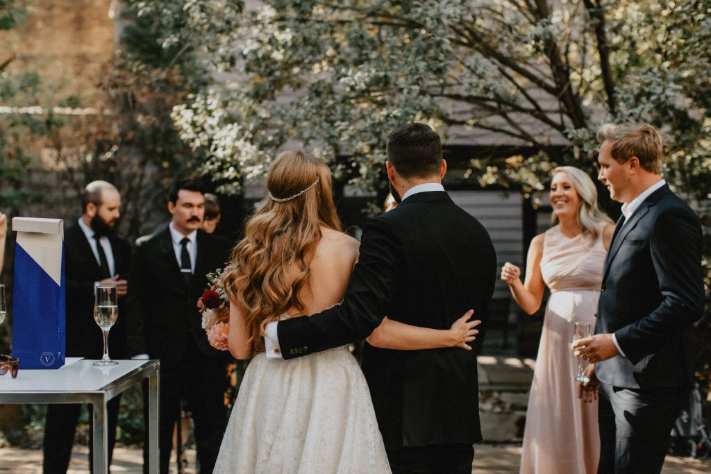 Bride and groom embrace during reception - Autumn Micro Wedding at Berkeley Fieldhouse