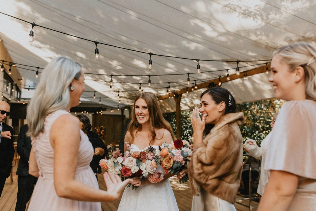 Bride laughs with bridesmaids - Autumn Micro Wedding at Berkeley Fieldhouse