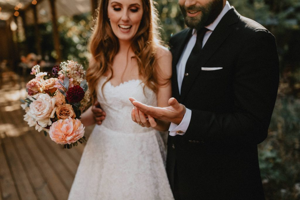 Bride and groom admire wedding rings - Autumn Micro Wedding at Berkeley Fieldhouse