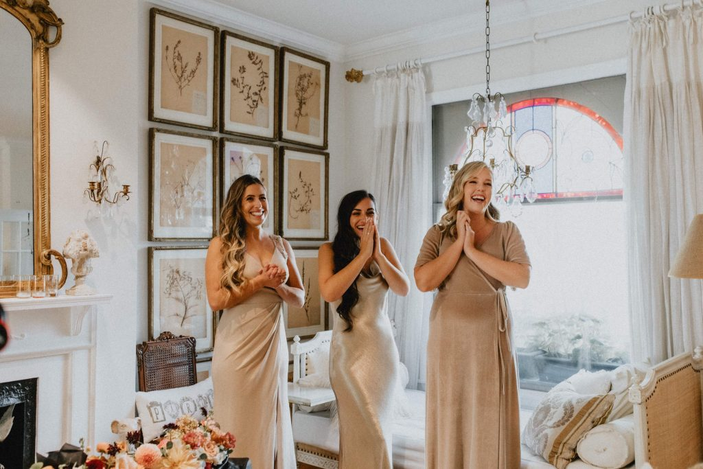 First look reaction from bridesmaids - Autumn Micro Wedding at Berkeley Fieldhouse