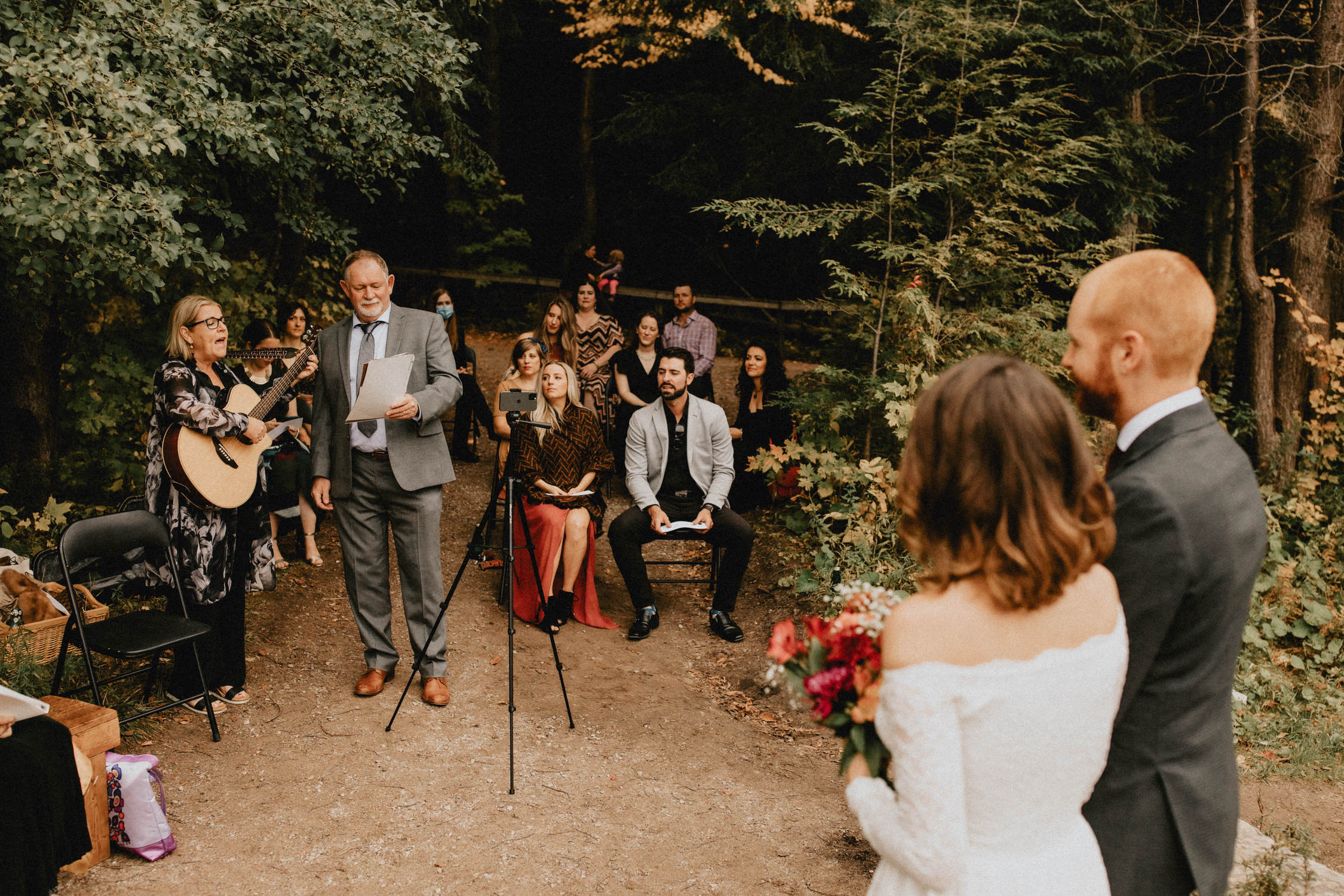 Parents sing to bride and groom during forest ceremony - Huron Natural Area Micro Wedding Kitchener, Ontario